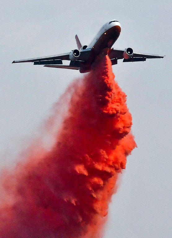 Description of . A DC-10 makes a fire retardant drop on a brush fire in the canyons along Highway 243 south of Banning on Saturday, May 4, 2013. More than 400 firefighters battled the 650-acre fire on Saturday. (Rachel Luna / Staff Photographer)