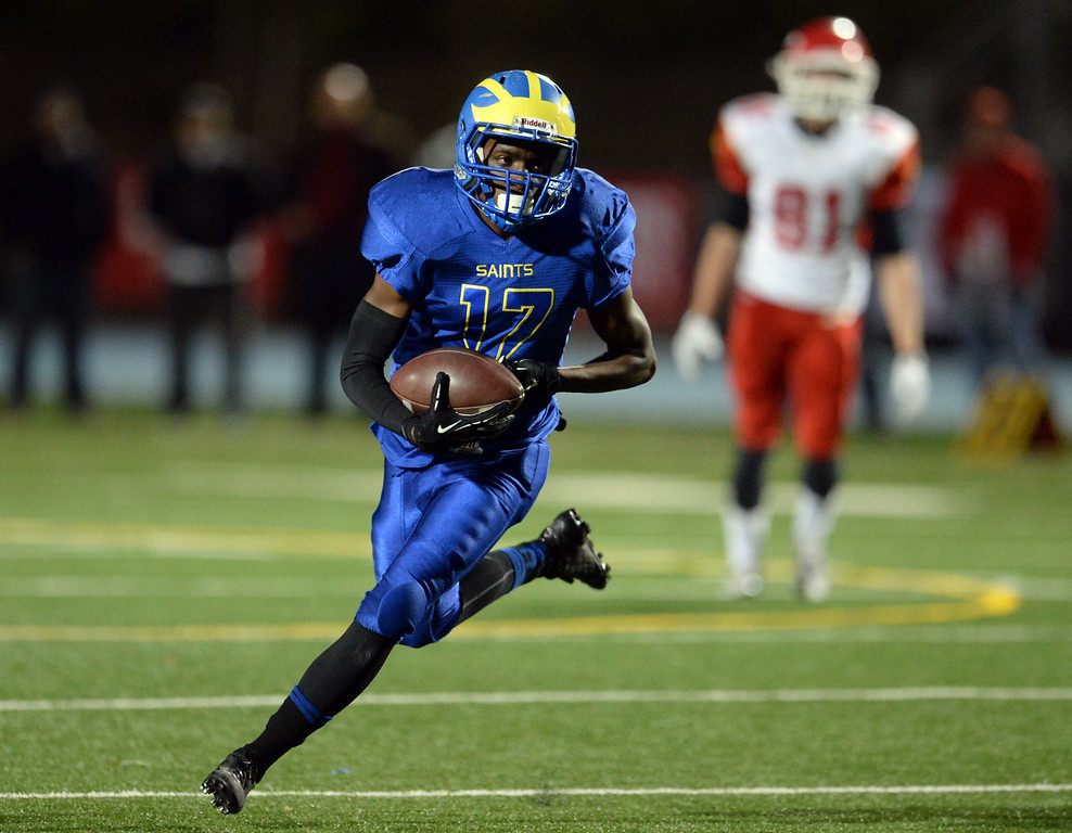 Description of . San Dimas' Chris Rufus runs for a first  down against Paraclete in the first half of a CIF-SS Mid-Valley Division championship football game at San Dimas High School in San Dimas, Calif., on Friday, Dec. 6, 2013.   (Keith Birmingham Pasadena Star-News)