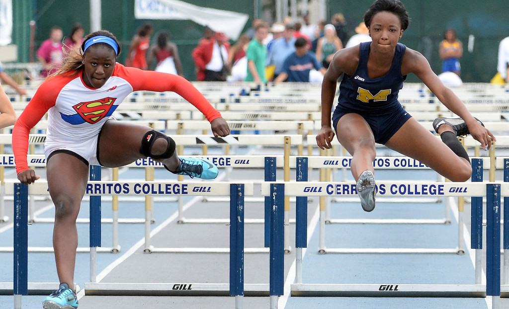 Description of . Serra's Jeanette Paul, left, wins the division 4 100 meter high hurdles past Muir's Keeya Cotlage during the CIF Southern Section track and final Championships at Cerritos College in Norwalk, Calif., Saturday, May 24, 2014. 
