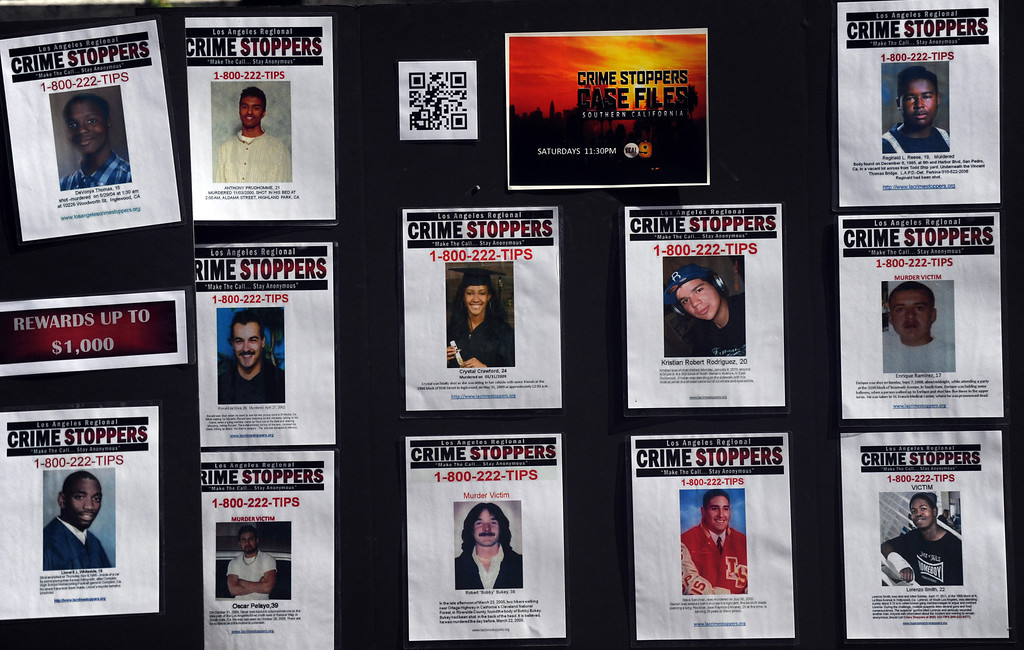 Description of . Victims during a Los Angeles County Sheriff's Department and Justice for Murdered Children unsolved homicide summit at the Los Angeles County Sheriff's headquarters on Saturday, July 20, 2013 in Monterey Park, Calif.  (Keith Birmingham/Pasadena Star-News)