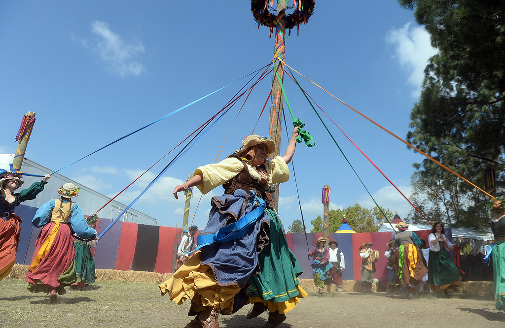 Description of . Performers dance around the may pole on opening day of the Renaissance Pleasure Faire at Santa Fe Dam Recreation Area in Irwindale, Calif., on Saturday, April 5, 2014. 