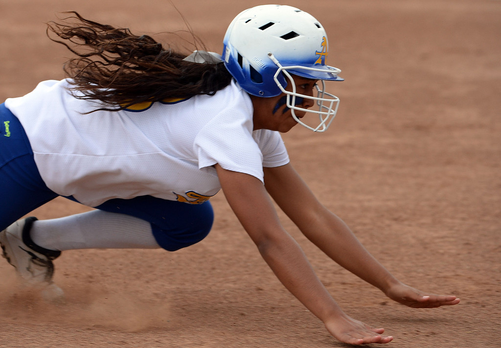 Description of . Bishop Amat's Sofia Venegas moves to third base on a single by Amanda Sanchez (C) (not pictured) in the first inning of a prep playoff softball game against La Serna at Bishop Amat High School in La Puente, Calif., on Thursday, May 22, 2014. La Serna won 6-0.   (Keith Birmingham/Pasadena Star-News)