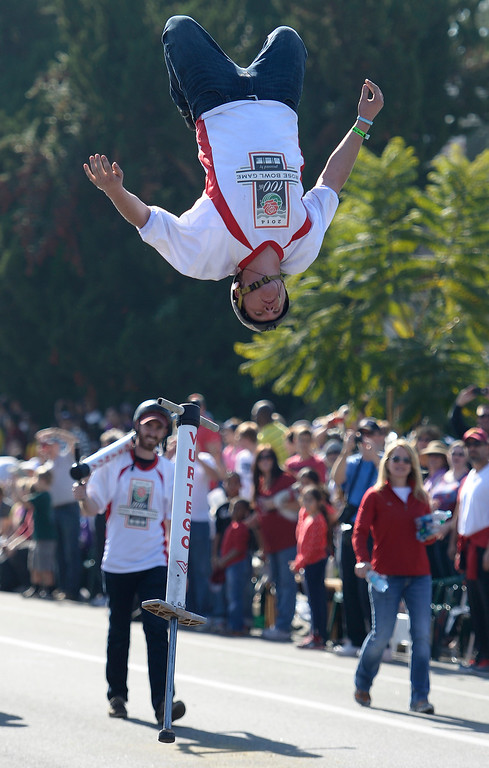 Description of . Xpogo pogo stick rider gets some big air near the end of the parade route during the 2014 Rose Parade in Pasadena, CA January 1, 2014.(John McCoy/Los Angeles Daily News)