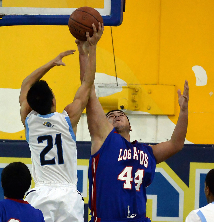 Description of . Walnut's Jeff Huang (21) drives to the basket past Los Altos' Jayson Jones (44) in the first half of a prep basketball game at Walnut High School in Walnut, Calif., on Wednesday, Jan. 22, 2014. (Keith Birmingham Pasadena Star-News)