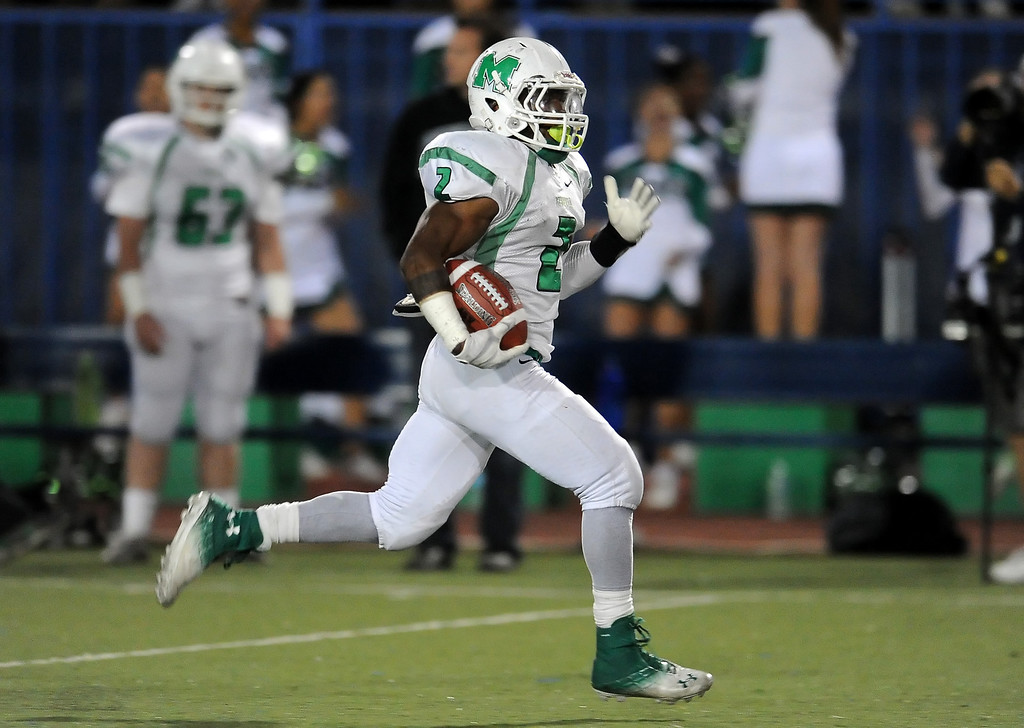 Description of . Monrovia's Kurt Scoby catches pass for a 69 yard touchdown run against San Marino in the first half of a prep football game at Monrovia High School in Monrovia, Calif., on Friday, Nov. 8, 2013. 