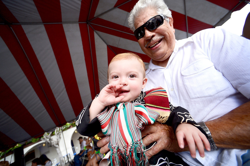 Description of . Landon Herrera, 11 months, of San Gabriel, is about to compete in a children's costume contest as he sits with his 88-year-old great-grandfather Manuel during the 242nd Annual La Fiesta de San Gabriel Saturday, August 31, 2013 at the San Gabriel Mission. Landon was the third generation in the Herrera family to wear the Charro costume. Jorge Ruiz, 8, of San Gabriel, is wearing a Oaxacan outfit. The fiesta runs through Sunday. (Photo by Sarah Reingewirtz/Pasadena Star-News)