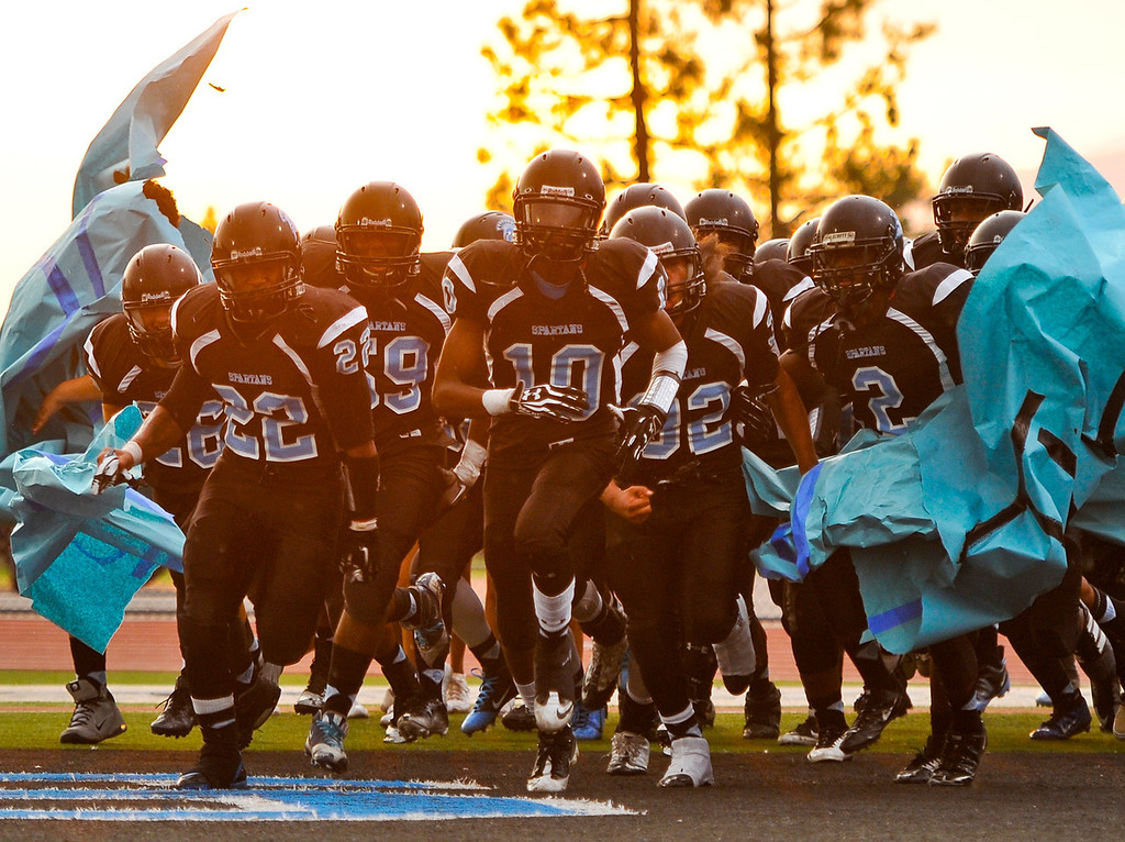 Description of . San Gorgonio varsity football races onto the football field for their season opener home game against Citrus Valley High School in San Bernardino on Friday, Aug. 30, 2013. (Rachel Luna / Staff Photographer)