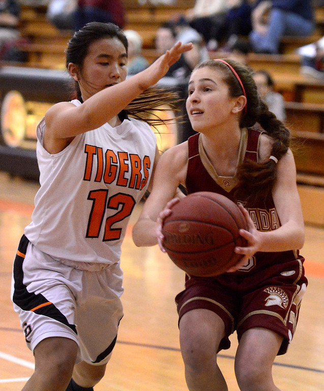 Description of . La Canada's Sarah Kurdoghlian (3) looks to pass while South Pasadena's Michelle Gin (12) blocks her during South Pasadena's 66-58 win Friday night, January 31, 2014 at South Pasadena High School. (Photo by Sarah Reingewirtz/Pasadena Star-News)