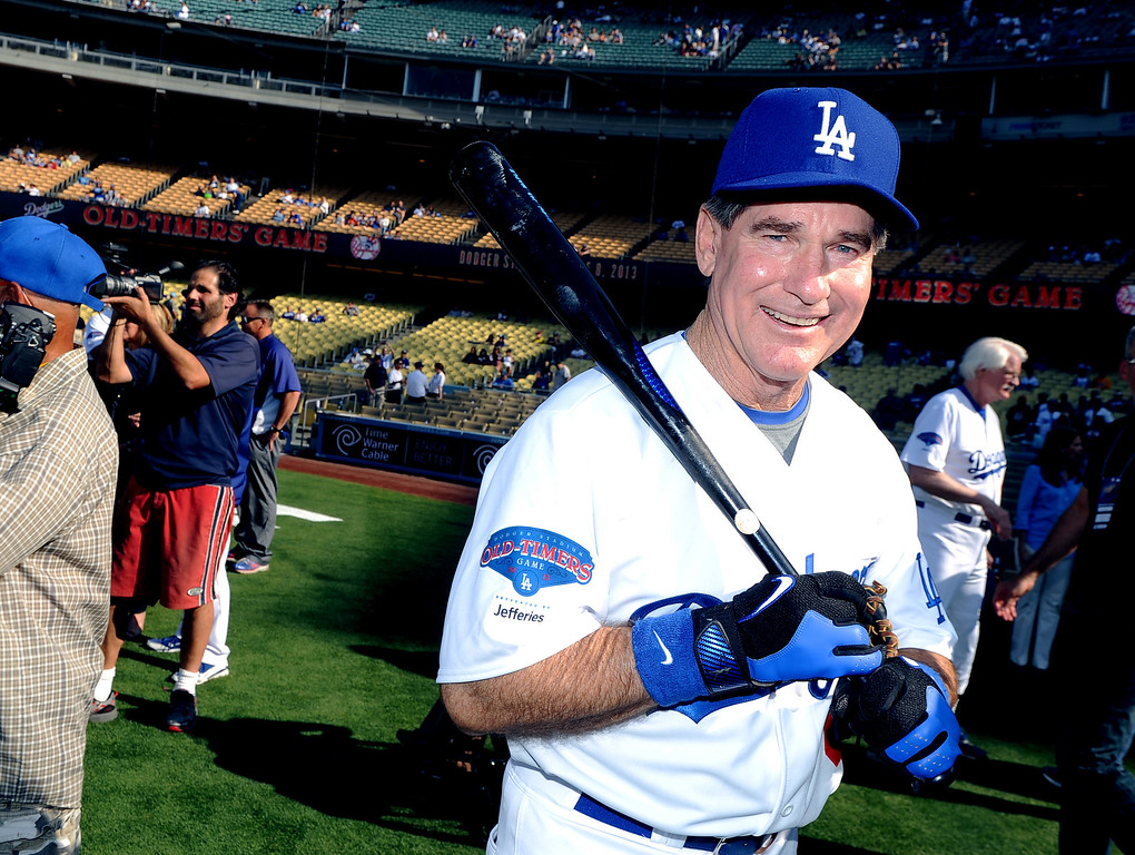 Description of . Former Los Angeles Dodgers first baseman Steve Garvey during the Old-Timers game prior to a baseball game between the Atlanta Braves and the Los Angeles Dodgers on Saturday, June 8, 2013 in Los Angeles. 