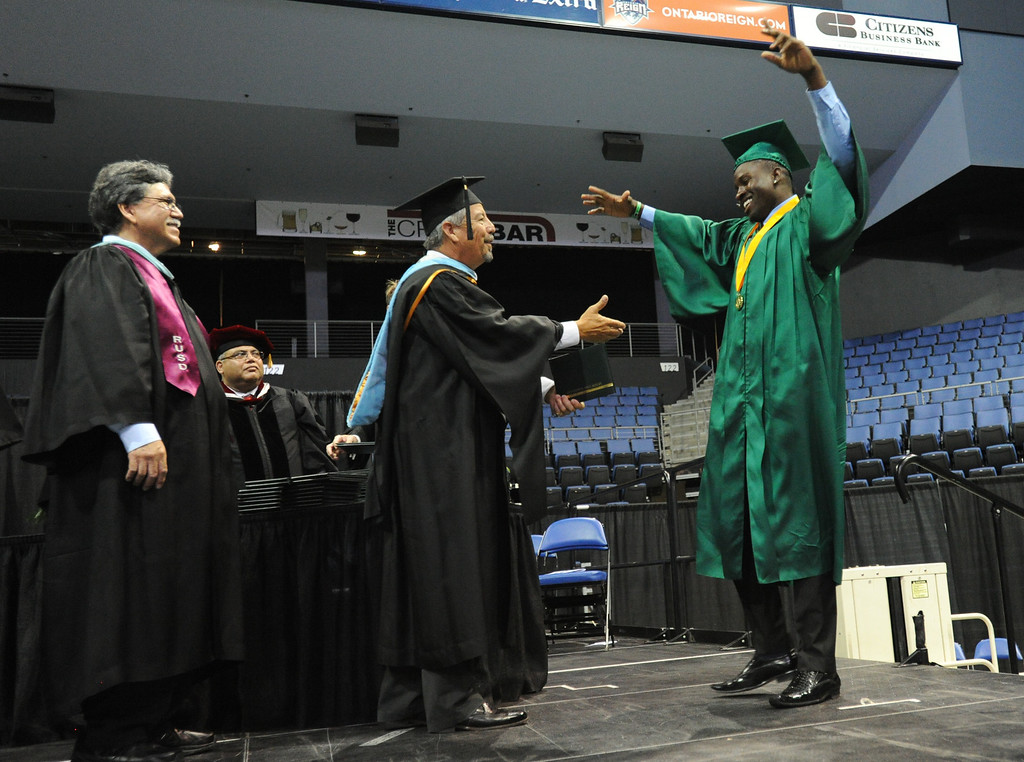 Description of . Eisenhower High School's 2014 Commencement ceremony at Citizens Business Bank Arena in Ontario, Ca., Sunday June 1, 2014. (Photo by John Valenzuela/ Inland Valley Daily Bulletin)