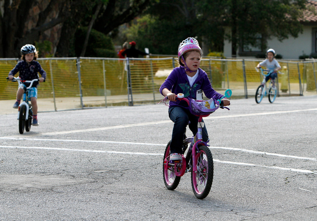 Description of . Riders participate in the public race portion of the Redlands Bicycle Classic on Saturday, April 5, 2014 in Redlands, Ca. (Photo by Micah Escamilla for the Redlands Daily Facts)
