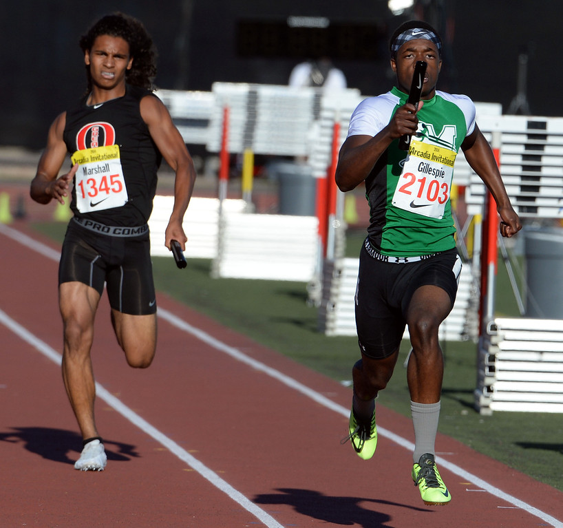 Description of . Monrovia's Cravon Gillespie, right, ahead of Great Oak's Damion Marshall competes in the 4x200 Invitational during the Arcadia Invitational track and field meet at Arcadia High School in Arcadia, Calif., on Friday, April 11, 2014. Rocky Mountain won the race as Redondo Union finished second. (Keith Birmingham Pasadena Star-News)