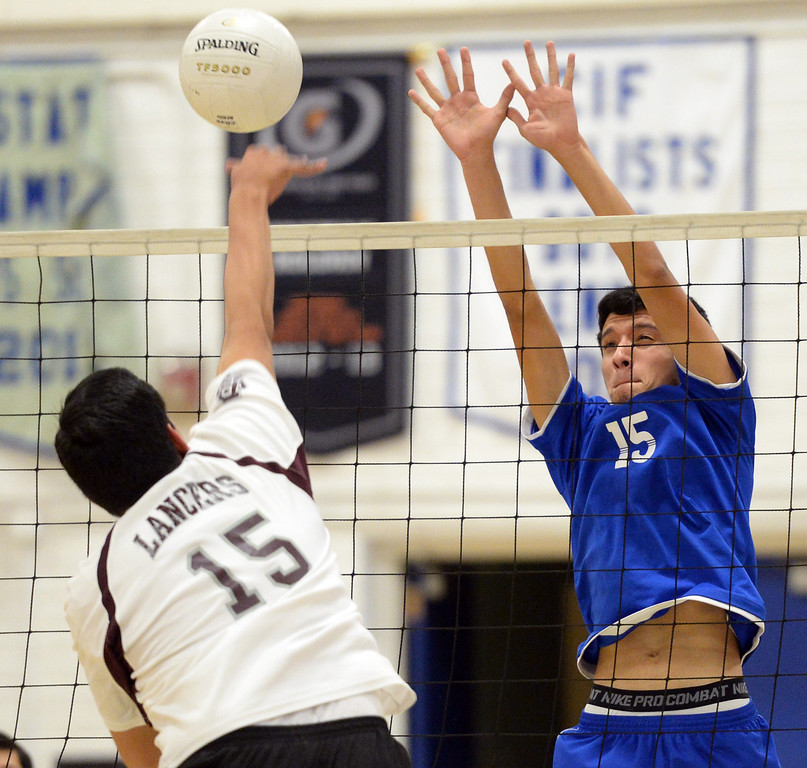 Description of . El Rancho's Bryan Rojas (#15) jumps up to block a shot from Bell Gardens' Bryan Diaz (#15) in their non-league game at El Rancho High School in Pico Rivera on Friday March 28, 2014. Bell Gardens defeated El Rancho 3-2 games. (Staff Photo by Keith Durflinger/Whittier Daily News)