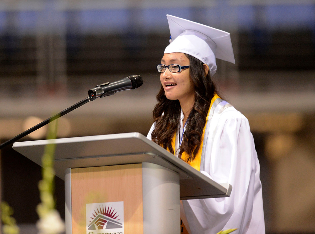 Description of . Valadictorian Cindy Wongkar addresses classmates during Rialto High School Commencement Exercises held at Citizens Bank Arena in Ontario June 2, 2013.  GABRIEL LUIS ACOSTA/STAFF PHOTOGRAPHER.