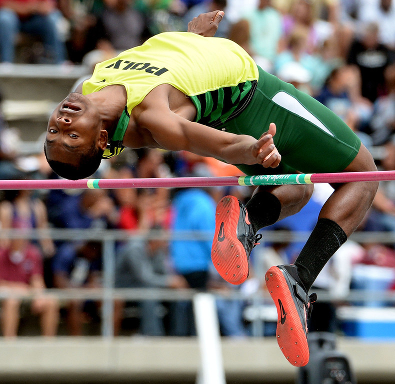 Description of . Long Beach Poly's Vincent Calhoun competes in the division 1 high jump during the CIF Southern Section track and final Championships at Cerritos College in Norwalk, Calif., on Saturday, May 24, 2014. 