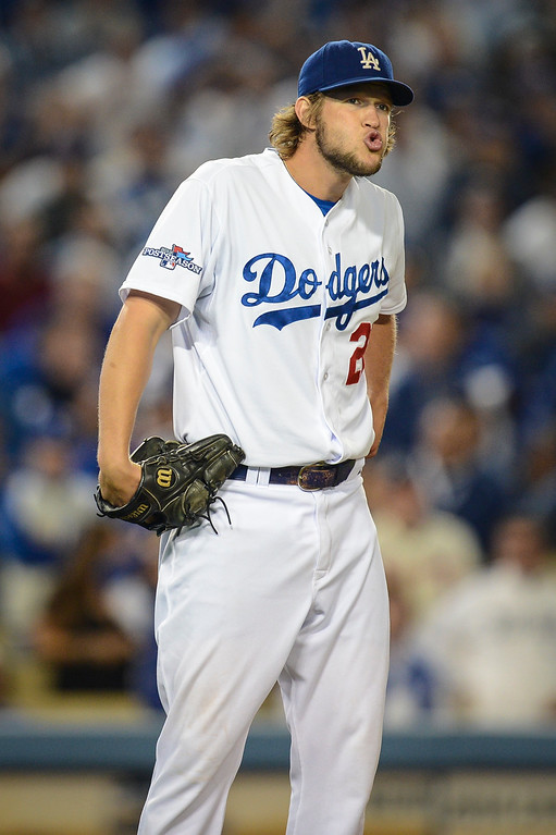 Description of . Dodgers' Clayton Kershaw takes a deep breath in the 6th inning.  Kershaw pitched six complete innings against the Braves during game 4 action Monday, October 7, 2013 ( Photo by Hans Gutknecht/Los Angeles Daily News )