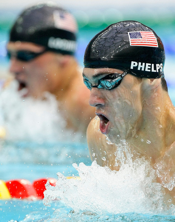 Description of . United States\' Michael Phelps swims to win the gold medal in the men\'s 200-meter individual medley final during the swimming competitions in the National Aquatics Center at the Beijing 2008 Olympics in Beijing, Friday, Aug. 15, 2008. (AP Photo/Itsuo Inouye)