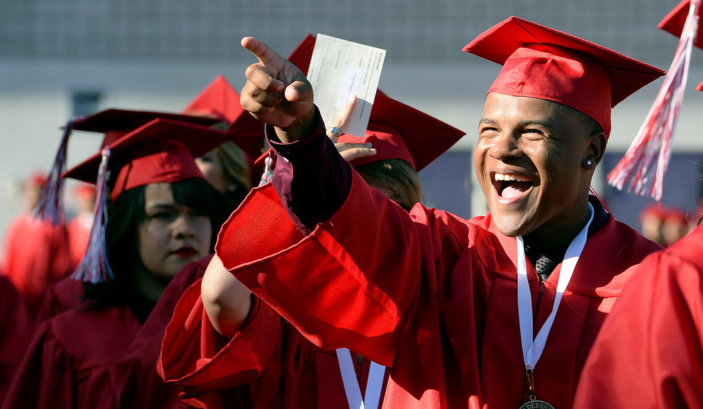 Description of . A graduate points towards the stands during the Whittier High School graduation at Whittier College in Whittier, Calif., on Wednesday, June 4, 2014.  (Keith Birmingham/Pasadena Star-News)