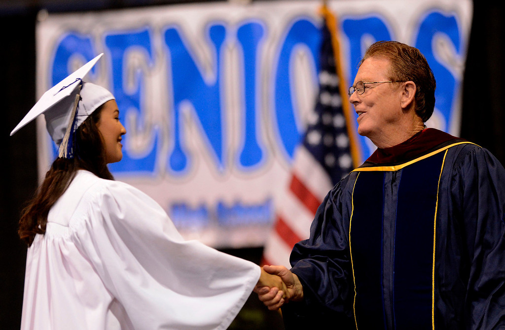 Description of . Students receive their diplomas during the Rialto High School Commencement Exercises held at Citizens Bank Arena in Ontario June 2, 2013.  GABRIEL LUIS ACOSTA/STAFF PHOTOGRAPHER.
