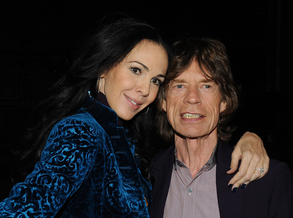 Description of . Designer L'Wren Scott and musician Mick Jagger pose at the L'Wren Scott Fall 2012 fashion show during Mercedes-Benz Fashion Week at  the Desmond Tutu Center on February 16, 2012 in New York City.  (Photo by Slaven Vlasic/Getty Images)