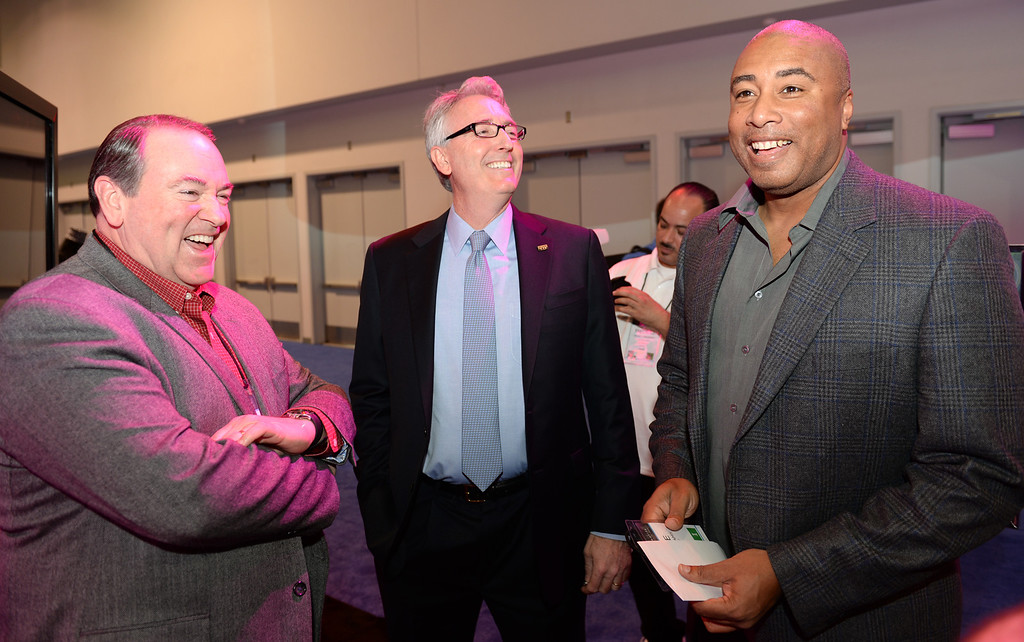 Description of . President and CEO Joe Lamond, center, visits with former Governor Mike Huckabee, left, and former New York Yankee Bernie Williams, right during the Media Preview event for the NAMM Show at the Anaheim Convention Center on Wednesday January 22, 2014. The NAMM Show, National Association of Music Merchants, is a trade-only event for the music products industry that is held every January. It is one of the two largest music product trade shows in the world. (Staff Photo by Keith Durflinger/San Gabriel Valley Tribune)