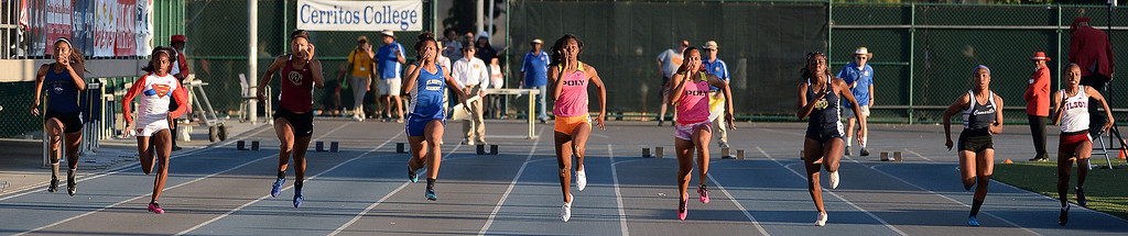 Description of . Vista Murrieta's Michelle Norman, left, Serra's Jasmin Reed, Oaks Christian's Schuyler Moore, St. Mary's Academy's Sierra Peterson, Long Beach Poly's Arianna Washington, center, teammate Jade Lewis, Notre Dame's Dontella Asemota, Camarillo's Zaria Francis and  Long Beach Wilson's Ashleigh Chambers in the 100 meter dash during the CIF-SS Masters Track and Field meet at Falcon Field on the campus of Cerritos College in Norwalk, Calif., on Friday, May 30, 2014. Washington won the race.    (Keith Birmingham/Pasadena Star-News)