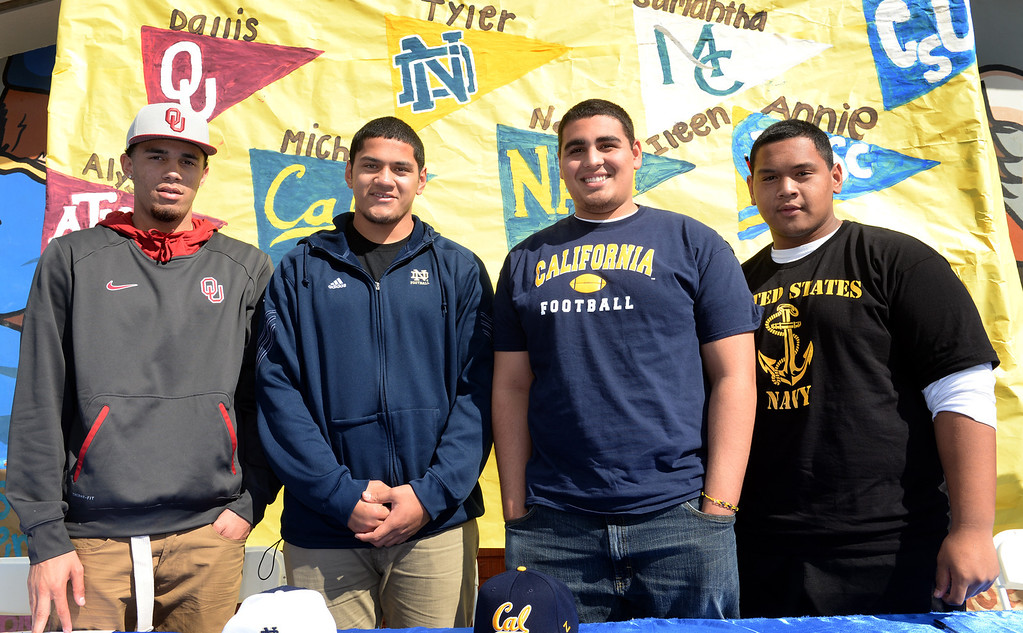 Description of . Football players, from left, Dallis Todd, Oklahoma, Tyler Luatua, Notre Dame, Michael Trani, Cal, and Nofo Ti'i, Navy, appear during National Signing Day at La Mirada High School on Wednesday February 5, 2014. (Staff Photo by Keith Durflinger/Whittier Daily News)