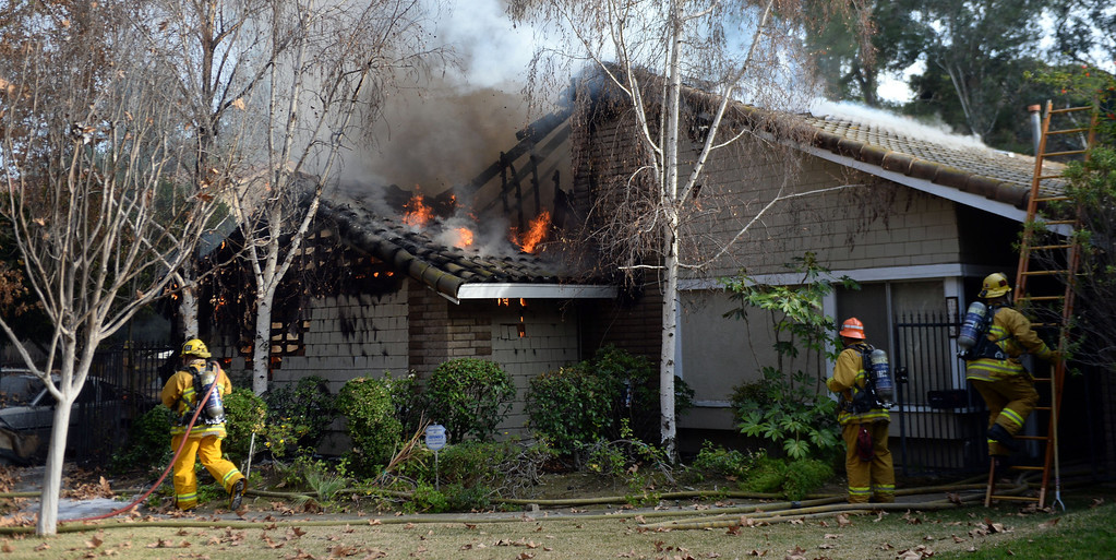 Description of . Los Angeles County Firefighters battle a fire that damaged a single family home. The fire started in the garage along the 1300 block of Via Verde. No injuries, but 5 cars were destroyed including two jaguars in San Dimas, Calif., on Saturday, Jan.4, 2014.   (Keith Birmingham Pasadena Star-News)