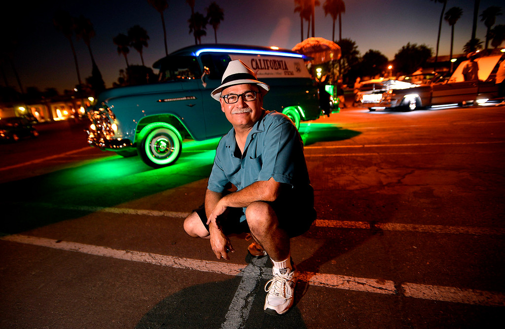 Description of . Pete Rodriquez, 56, of Hesperia, poses with his 1956 Chevrolet Panel truck prior to competing in the Neon Light Contest during Day 2 of the 23rd Annual Stater Brothers Route 66 Rendezvous in downtown San Bernardino September 14, 2012.  Rodriguez was competing for the 11th straight year in the annual competition.  (Photo by Gabriel Luis Acosta/The Sun)