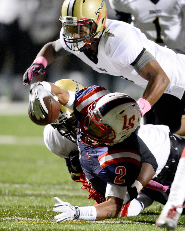 Description of . La Salle's Bryce Harvey (2) is tackled by gains yards as Bishop Montgomery during the second quarter in Friday night's football game at La Salle High School in Pasadena, October 25, 2013.  (Photo by Sarah Reingewirtz/Pasadena Star-News)