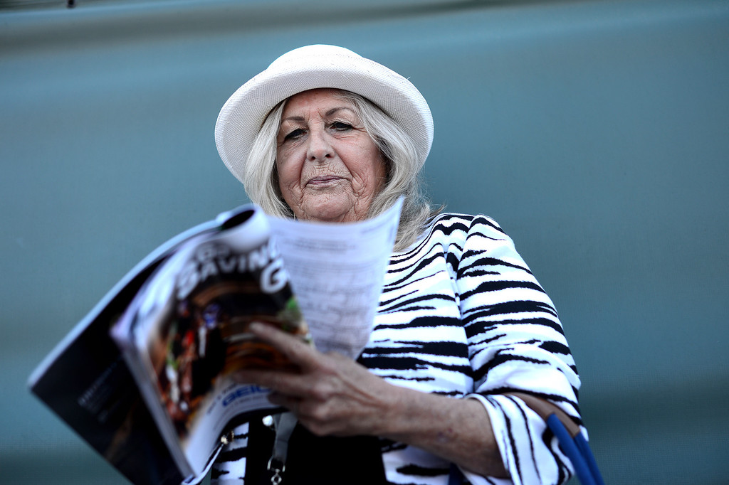 Description of . Penny Stevens, of Laguna Woods, studies the horses during the Breeders' Cup at Santa Anita Park in Arcadia Friday, November 1, 2013. (Photo by Sarah Reingewirtz/Pasadena Star-News)