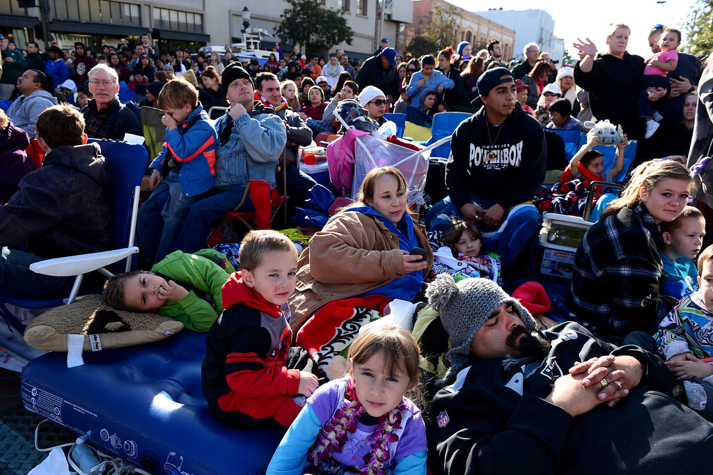 Description of . David Bustamante, of Covina, lays down with his children as he watches the 125th Rose Parade in Pasadena, CA January 1, 2014. (Photo by Sarah Reingewirtz/Pasadena Star-News)