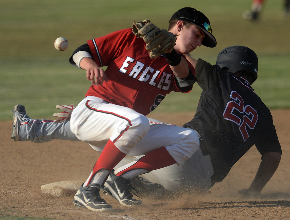 Description of . Etiwanda's Brett Campagna, left, misses the throw to third as Glendora's Eric Flores slides in safe Friday, May 3, 2013, at Etiwanda High School in Rancho Cucamonga.(Staff photo by Jennifer Cappuccio Maher)