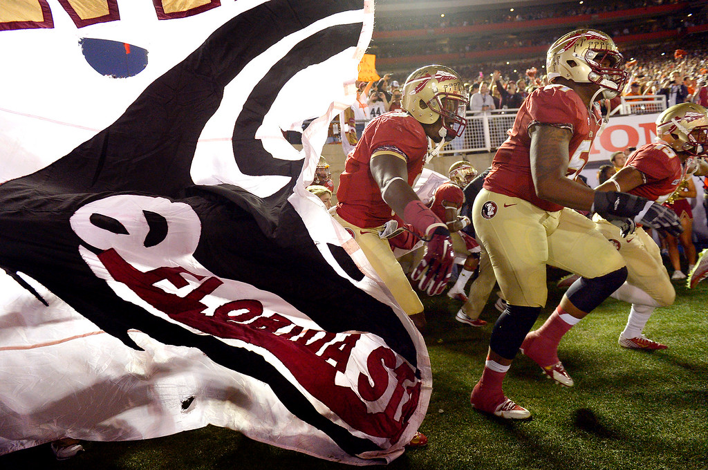 Description of . The Florida State football team makes their way onto the field prior to the start of 2014 Vizio BCS National Championship game January 6, 2014 in Pasadena CA.  Florida State won the game 34-31.(Andy Holzman/Los Angeles Daily News)