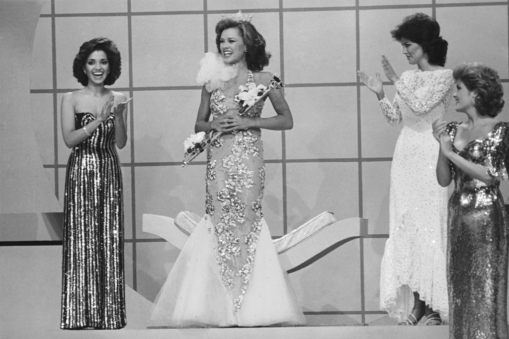 Description of . Suzette Charles, Miss New Jersey, the first runner up, applauds the newly crowned Miss America, Vanessa Williams, Sept. 17, 1983 in Atlantic City. It is the first time there have been two blacks in that position. (AP Photo)
