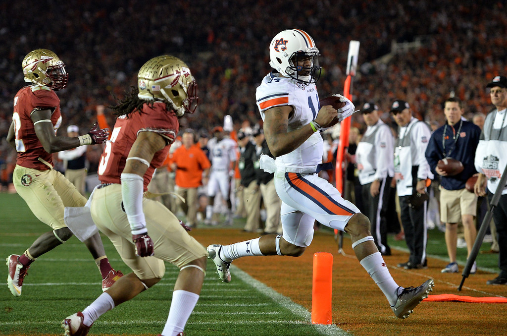 Description of . Auburn QB Nick Marshall runs for a second quarter touchdown against Florida State at the BCS national championship game at the Rose Bowl, Monday, January 6, 2014. (Photo by Michael Owen Baker/L.A. Daily News)
