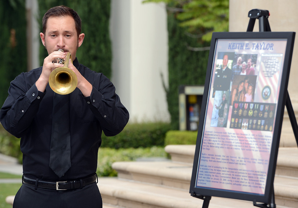 Description of . Matthew Busch, a Masters student in Performance, plays taps during a memorial service for fallen service members was held Friday May 17, 2013 in front of the Memorial Chapel at the university. The ceremony featured a special tribute to Keith Taylor, a University of Redlands alumnus and father of a University of Redlands student. He was killed serving in Iraq. (Rick Sforza/Staff photographer, Redlands Daily Facts)