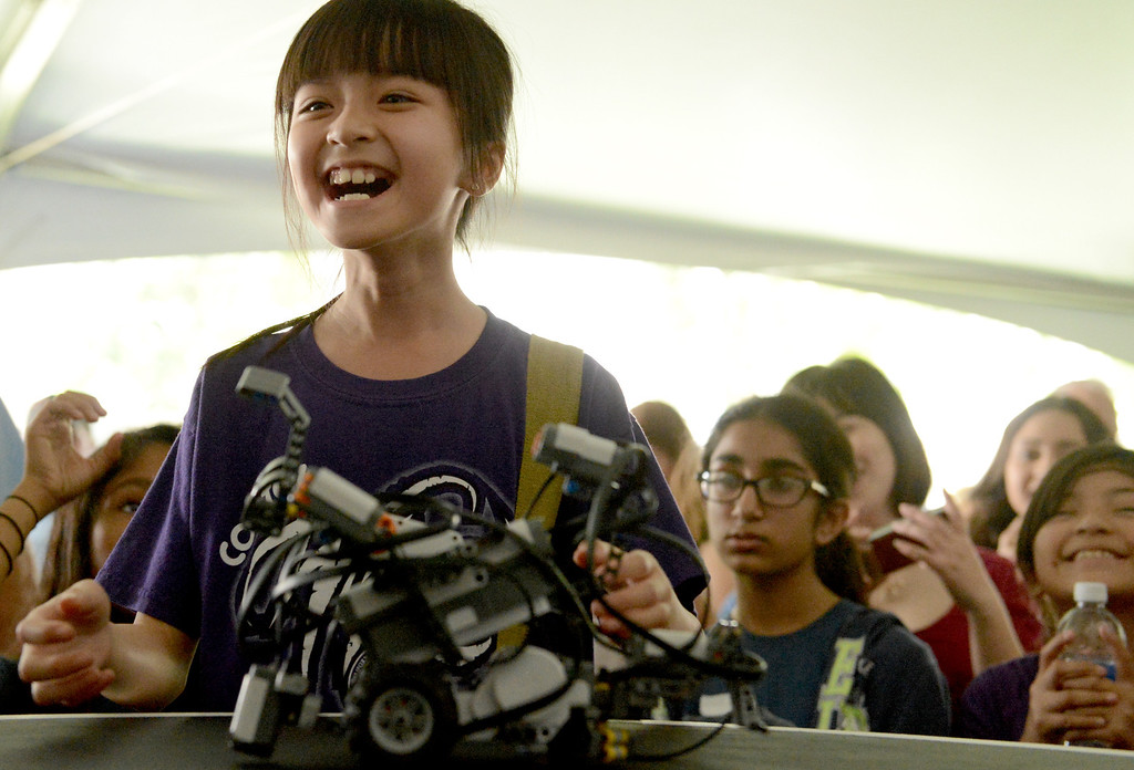 Description of . 0511_NWS_IDB_L-ROBOTRALLY-01-TRC (Thomas R. Cordova/Staff Photographer) Vivien Nguyen, 9 of Pomona, reacts to her teams win after a robot sumo wrestling match at Cal Poly in Pomona May 10, 2013. More than 800 elementary school students from across Southern California are expected at the university's annual Robot Rally, the largest in the nation. Students from 13 schools will watch their robots compete in a variety of challenges, including sumo wrestling, speed trials and an obstacle course.