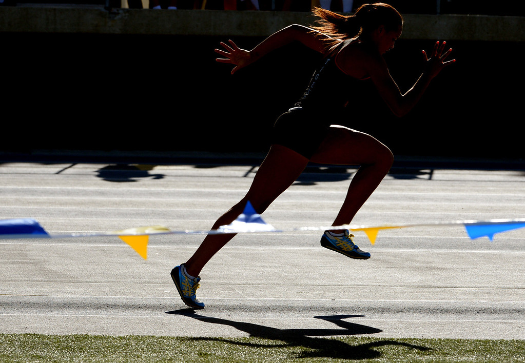 Description of . South Pasadena's Jazmin Jackmon competes in the long jump during the CIF-SS Masters Track and Field meet at Falcon Field on the campus of Cerritos College in Norwalk, Calif., on Friday, May 30, 2014.   (Keith Birmingham/Pasadena Star-News)