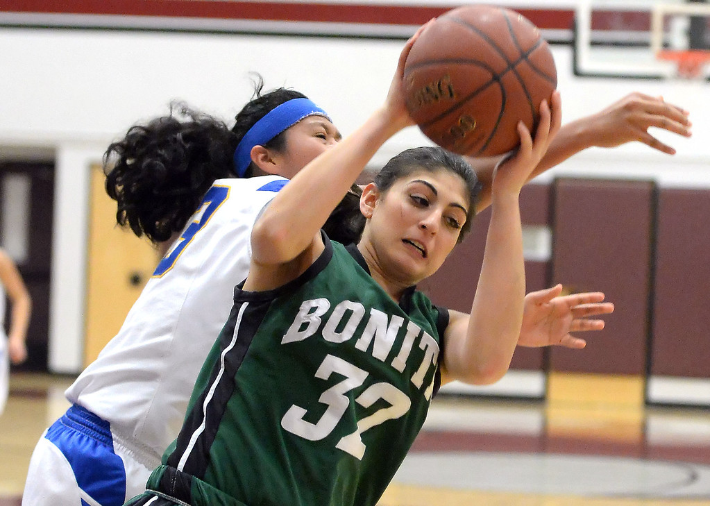 Description of . Bonita's Kandyce Smith (32) rebounds against Bishop Amat in the first half of the Covina basketball tournament at Covina High School in Covina, Calif., on Saturday, Dec. 14, 2013. Bonita won 49-41.   (Keith Birmingham Pasadena Star-News)