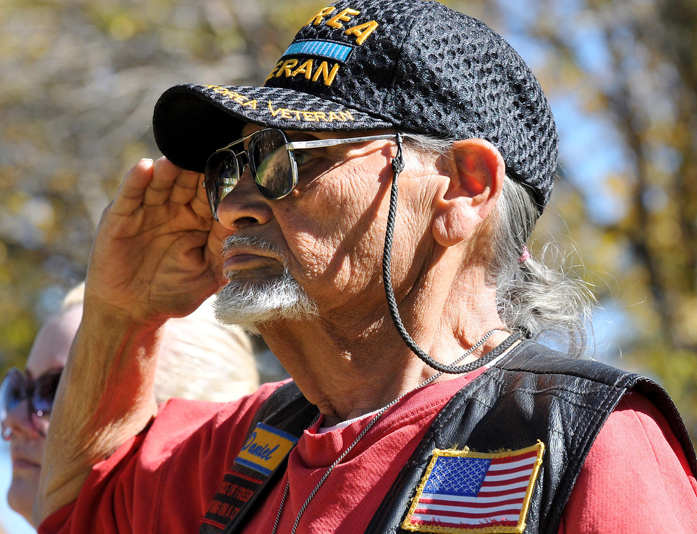 Description of . (John Valenzuela/Staff Photographer) Military veteran Daniel Lopez of San Bernardino salutes the flag during the playing of the National Anthem at the Veterans Day ceremony in Redlands, Nov. 11, 2013. The City of Redlands and American Legion Posts 106 & 650 hosted a Veterans Day Parade along with a ceremony honoring all who served with a special Tribute to Korean War Veterans, at Jennie Davis Park in Redlands, CA.