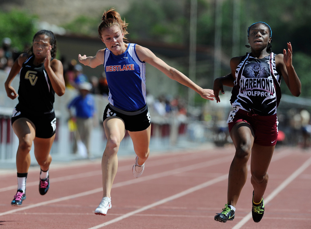 Description of . Golden Valley, Azaria Hill ,and Westlake, Abigail Smith, can not catch Claremont, Brittany Brown, in the girls 100 meters in the 2013 CIF Southern Section Track & Field Divisional Finals held at Mt. San Antonio College in Walnut, CA 5/18/2013(John McCoy/LA Daily News)