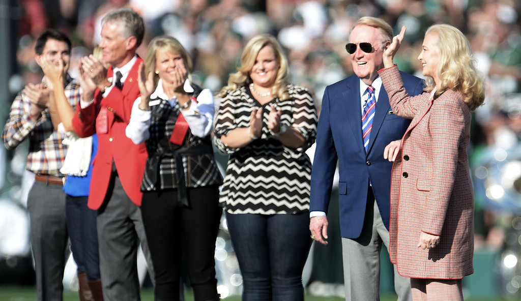 Description of . Rose Parade grand marshal Vin Scully, second from right, with his wife Sandy, right, prior to the 100th Rose bowl game between Stanford and Michigan State in Pasadena, Calif., on Wednesday, Jan.1, 2014. 
