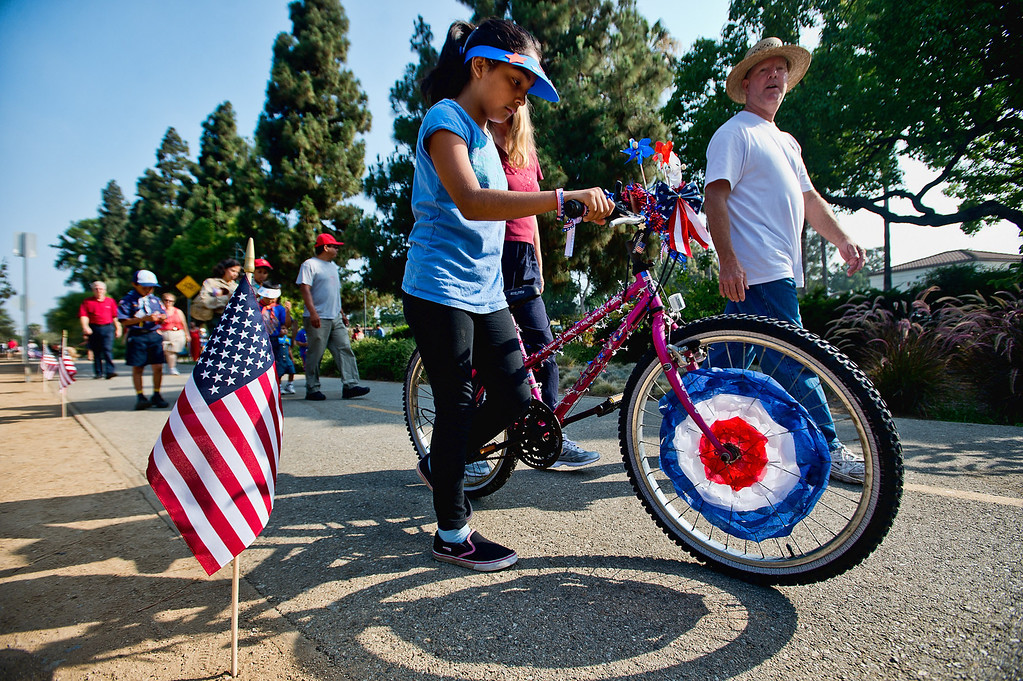 Description of . Local residents participate in the freedom walk, a 4th of July community procession along the Greenway Trail, in Whittier on Thursday, July 4, 2013. (SGVN/Staff photo by Watchara Phomicinda)
