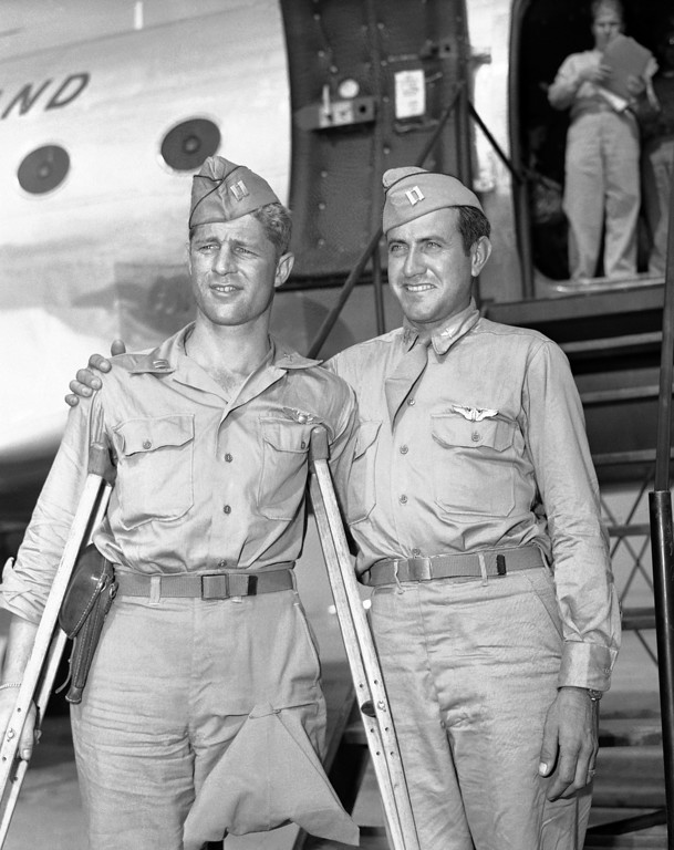 Description of . Capt. Louis Zamperini (right), Torrence, Calif., former track star, who was adrift 47 days in Pacific after bombing mission against Japanese presumed dead, stands with his Pal, Capt. Fred Garrett, Riverside, Calif., upon their arrival at Hamilton Field, Calif., on Oct. 3, 1945. Both were prisoners of Japan. (AP Photo/PCS)