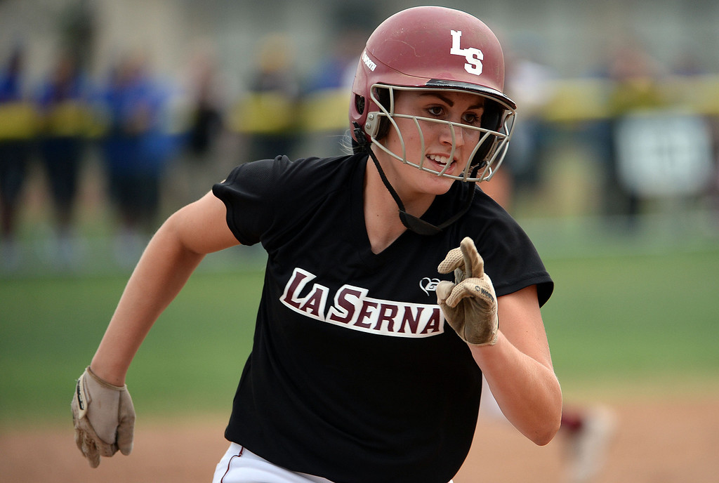 Description of . La Serna's Molly Bourne moves to third in the second inning of a prep playoff softball game against Bishop Amat at Bishop Amat High School in La Puente, Calif., on Thursday, May 22, 2014. La Serna won 6-0.   (Keith Birmingham/Pasadena Star-News)