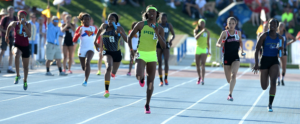 Description of . Long Beach Poly's Ariana Washington runs the final leg as they win the 4x100 meter relay during the CIF California State Track & Field Championships at Veteran's Memorial Stadium on the campus of Buchanan High School in Clovis, Calif., on Saturday, June 7, 2014. 