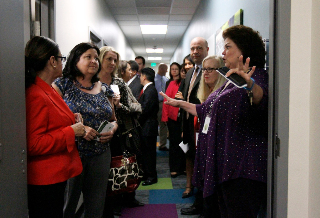 Description of . Volunteer Kay Wick, right, leads a tour through the new Children's Assessment Center in which an entire wing has been dedicated in memory of slain San Bernardino County Sheriff's Deputy Jeremiah MacKay on Wednesday, May 21, 2014 at the Children's Assessment Center in San Bernardino, Ca. (Photo by Micah Escamilla/San Bernardino Sun)
