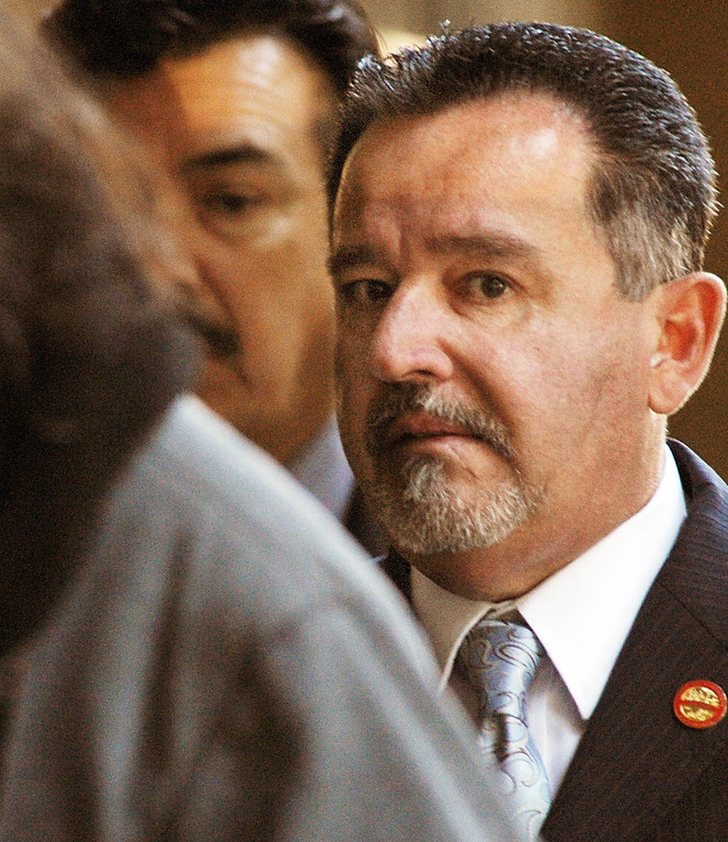 Description of . Councilman, Manuel Garcia, and Mayor Mark Breceda, right, entering Clara Shortridge Foltz Criminal Justice Center. Former Irwindale Councilwoman Rosemary Ramirez, Councilman, Manuel Garcia,  Mayor Mark Breceda, and Finance Director Abe DeDios were with their attorneys at Clara Shortridge Foltz Criminal Justice Center Thursday, February 27, 2014.  Irwindale officials are accused of misappropriation of public funds, conflict of interest and embezzlement spending $200,000 on trips to New York City between 2001-2005.  Their arraignment was postponed once again to April 9, 2014.(Photo by Walt Mancini/San Gabriel Valley Tribune)