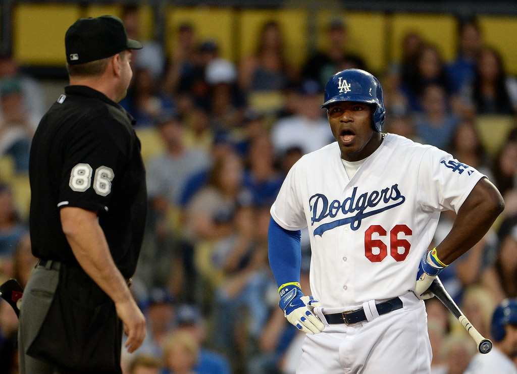 Description of . Los Angeles Dodgers' Yasiel Puig (66) is ejected from the game by home plate umpire David Rackley (86) after being called out on a third strike pitch in the third inning of a Major league baseball game against the San Diego Padres on Saturday, July 12, 2014 in Los Angeles.   (Keith Birmingham/Pasadena Star-News)